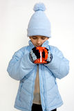 Little boy with cup of hot tea Stock Images