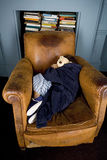 Little boy curled up asleep in armchair Stock Photo