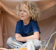 Little boy with curly blond hair, outside. A boy with curly blond hair, to the outside Stock Photos