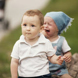 Little boy and crying girl Royalty Free Stock Photography