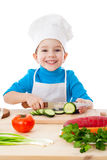 Little boy cutting the cucumber Royalty Free Stock Image