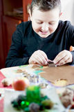 Little boy cutting xmas heart Royalty Free Stock Image