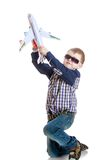 Little boy d sunglasses plays with toy plane Royalty Free Stock Photography