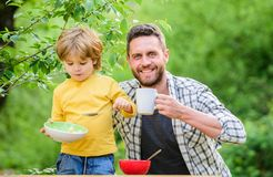 Little boy and dad eating. Nutrition kids and adults. Healthy nutrition concept. Menu for children. Nutrition habits. Family enjoy homemade meal. Healthy stock images
