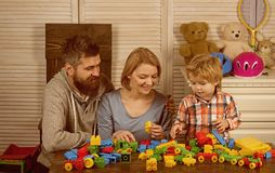 Little boy with dad mom. father and mother with child play constructor. happy family and childrens day. happy childhood. Care and development. little boy play stock image