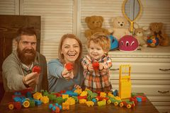 Little boy with dad mom. father and mother with child play constructor. happy family and childrens day. little boy play. With parents at home. happy childhood royalty free stock photography