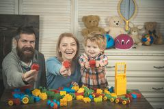 Little boy with dad mom. father and mother with child play constructor. happy family and childrens day. little boy play. With parents at home. happy childhood royalty free stock photo