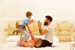 Little boy with dad and mom. father and mother with child play toys. happy childhood. Care and development. happy family. And childrens day. little boy play royalty free stock photography