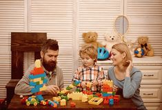 Little boy with dad and mom. happy childhood. Care and development. father and mother with child play constructor. happy. Family and childrens day. little boy stock photos