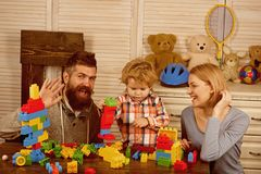 Little boy with dad mom. happy family and childrens day. father and mother with child play constructor. happy childhood. Care and development. little boy play stock photo