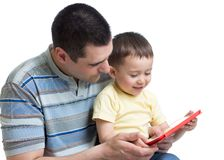 Little boy with dad playing with ipad. Isoated royalty free stock photos