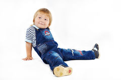 The little boy in dark blue overalls Stock Photo