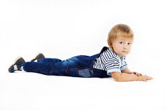 The little boy in dark blue overalls Stock Photos