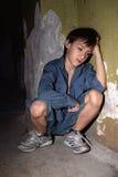Little boy in a dark cellar Royalty Free Stock Photography