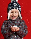 Winter portrait of cute little boy wearing warm cozy clothes studio shot with snow stock photo