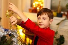 Little boy decorate christmas tree Royalty Free Stock Image