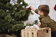 Little boy decorating Christmas tree Royalty Free Stock Photos
