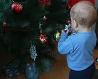 Little boy decorating Christmas tree Royalty Free Stock Images
