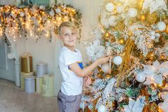 Little boy decorating Christmas tree at home royalty free stock photography