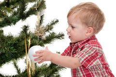 Little boy decorating a new year tree Royalty Free Stock Photos