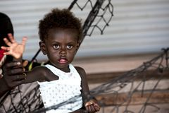Little boy with deep black eyes, cute baby boy in hammock, Priumeri, Shortland Islands, Solomon Islands, Royalty Free Stock Image