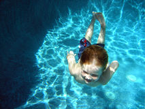Little boy, deep pool. Little boy swimming underwater in the deep end Royalty Free Stock Images