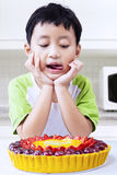 Little boy with fruit cake Royalty Free Stock Photography