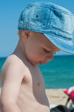 Little boy in denim cap Stock Images