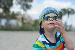 Little boy in denim hat and sunglasses Royalty Free Stock Photos