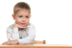 Little boy at the desk Royalty Free Stock Photo
