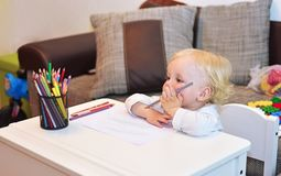Little boy at the desk. Classes with the child. royalty free stock photo