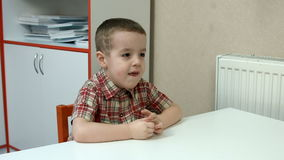 Little boy at the Desk stock video footage