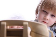 A little boy dialing Stock Photography