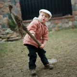 Little boy digging a hole Royalty Free Stock Images
