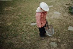 Little boy digging a hole Stock Photos