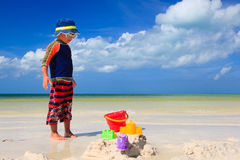 Little boy digging sand on tropical beach Royalty Free Stock Photo
