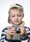Little boy with the digital photo camera Stock Photos