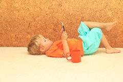Little boy with digital tablet at home Royalty Free Stock Photos