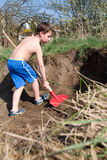Little boy digs a hole Royalty Free Stock Photography