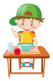 Little boy at dining table eating breakfast vector illustration