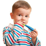 Little boy discovering teeth brushing Royalty Free Stock Image