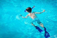 A little boy diving under water Stock Images