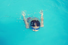 Little boy diving in water Royalty Free Stock Photo