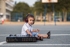 Little boy dj in the schoolyard Stock Photos