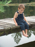 Little boy on dock. Little boy by fishing peer Royalty Free Stock Photography