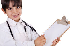 Little boy doctor writes Stock Photo