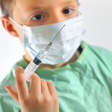 A little boy in a doctors uniform Royalty Free Stock Photography