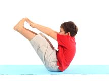 The little boy does exercise. Royalty Free Stock Images