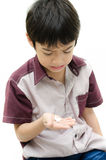 Little boy does'n want to take medicine pill Stock Photo
