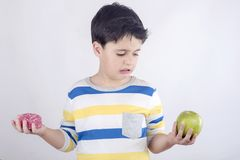 Little boy does not want to eat fruit Stock Image